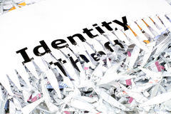 Identity Theft. This is an image of the words identity theft shredded, laying on shredded paper stock image