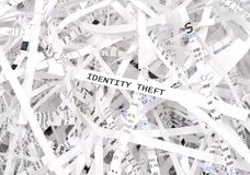 Identity theft. Text surrounded by shredded paper. Great concept for information protection stock photography