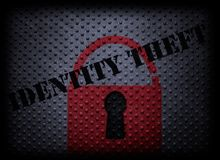 Identity theft concept. Red lock with Identity Theft text on textured background royalty free stock images