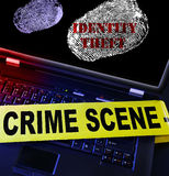 Identity Theft cybercrime. Identity Theft laptop fingerprint with crime scene tape Royalty Free Stock Photo