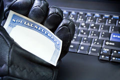 Identity theft on laptop computer Stock Image
