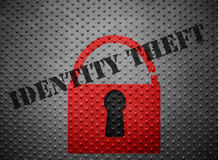 Identity theft lock. Broken red lock with Identity Theft stamp on metal background stock photography