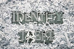 Identity theft. Phrase made from metallic letterpress type inside of shredded paper heap stock image