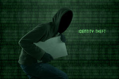 Identity theft. Portrait of Identity theft stealing a laptop computer Royalty Free Stock Images