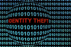 Identity Theft in Red. The words identity theft in red binary code on computer monitor stock photos