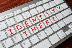 Identity Theft. Identity Theft written on a keyboard stock photography