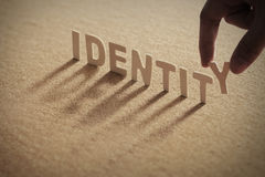 IDENTITY wood word on compressed board Stock Photography