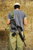 IDF soldier man carry an M-16 rifle pray Stock Photos