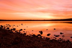 Idilic sunset over sea water. Orange sunset over ocean water Royalty Free Stock Photo