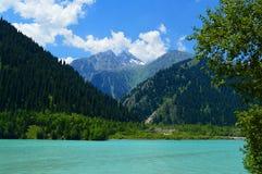 Idillyc july landscape with mountain lake Issyk, National Park, Kazakhstan Royalty Free Stock Photography