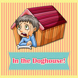 Idiom in the doghouse Royalty Free Stock Image