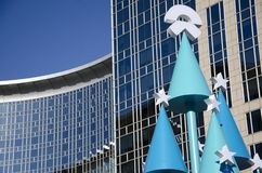 Merry Christmas and happy New Year!. The idiosyncratic Christmas tree is placed on the Plaza of the building Royalty Free Stock Photo