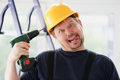 Idiot worker using electric drill portrait Stock Photography