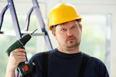 Idiot worker using electric drill portrait Royalty Free Stock Photos