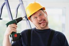 Idiotarbeider die elektrisch boorportret gebruiken Stock Fotografie