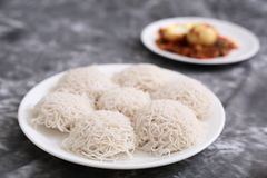 Idiyappam steam cooked rice noodles with egg masala Royalty Free Stock Images