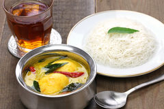 Idiyappam (string hoppers)  with egg curry Stock Photos