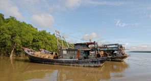 Idle boats waiting on Mekong river Royalty Free Stock Image