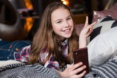 Idle child leisure girl using mobile phone home. Idle child leisure. girl using mobile phone at home. internet browsing and social network chatting stock images