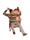 An idle Hispanic man coming his hair. Royalty Free Stock Image
