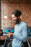 Idle leisure internet addiction tablet apps gaming. Idle leisure and internet addiction. man smiling while using tablet. apps and gaming stock photo