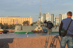 Idle mode. Waiting to start towing the cruiser Aurora in the factory for repair September 21, 2014. Saint-Petersburg, Russia stock images