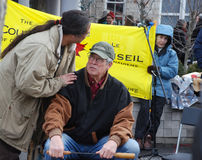IDLE NO MORE - Guelph, Ontario Protest. Protester confers with elder, at the Jan.12, 213 Idle No More protest, in Guelph, Ontario, Canada Stock Photography