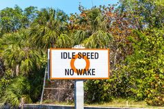 Idle Speed No Wake. A Sign for Idle Speed No Wake in the Intracoastal royalty free stock photos