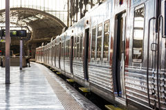 Idle Train Doors on Platform in Old European Train Station Sunny Stock Photos