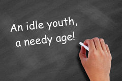 An idle youth, a needy age Royalty Free Stock Photography