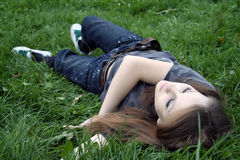 Idleness. A girl on the grass Royalty Free Stock Photography