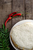Idli Indian food. Idli with red and green color spices on side stock photo