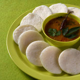 Idli with Sambar in bowl on green background, Indian Dish Stock Photo