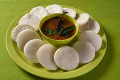 Idli with Sambar in bowl on green background, Indian Dish Stock Image