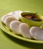 Idli with Sambar in bowl on green background, Indian Dish Royalty Free Stock Photos