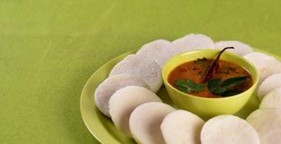 Idli with Sambar in bowl on green background, Indian Dish Royalty Free Stock Photography