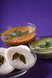 Idli with Sambar and coconut chutney on violet background, Indian Dish Stock Photos