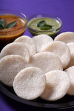 Idli with Sambar and coconut chutney on violet background, Indian Dish Royalty Free Stock Image