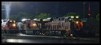 Idling Power. Two different freight crews depart there separate ways in the West Toronto yard royalty free stock image