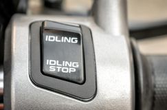 Idling Stop System Switch on a Motorcycle.  stock images