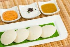 Idly / Idli with tomato & coconut chutney and sambar Stock Photo