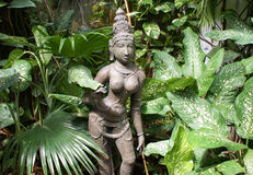Idol of hindu deity in greenery Royalty Free Stock Photos