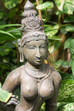 Idol of hindu deity in greenery Stock Photos