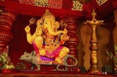 An idol of Lord Ganesha, sitting on his vehicle - a mouse, Guruji Talim Mandal, Pune, Maharashtra, India. royalty free stock photos