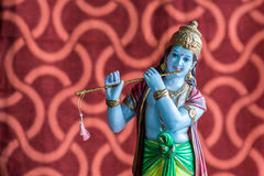 Idol of Lord Krishna. Lord Krishna with his favorite musical instrument, the flute, in this idol Stock Photography