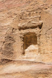 Idol niche in the Siq topped with a pediment. Seen from the trail to Petra Royalty Free Stock Photography