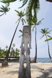 Idol and palms Stock Photo