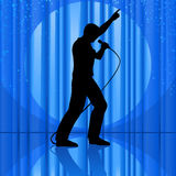 Idol On Stage. Vector clip art illustration of the silhouette of a singer singing to a microphone and pointing up, on theatrical stage, with curtains, spotlight Stock Image