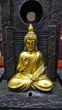 Idole d'or de Bouddha photo stock