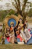 Idols of goddess Saraswati resting under a tree. Royalty Free Stock Photos